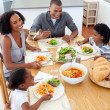 Happy family dining together — Stockfoto