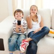 happy siblings watching tv — Stock Photo