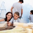 Family decorating their new home — Stock Photo