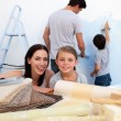 Happy family doing up their new home — Stock Photo