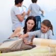 Young family renovating home after moving — Stock Photo #10316993