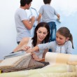 Stock Photo: Young family renovating home after moving