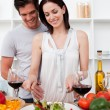 Portrait of a smiling couple cooking — Stock Photo #10316995