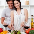 Portrait of a happy couple cooking — Stock Photo #10316996