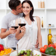 Lovers toasting with wine and cooking — Stock Photo