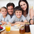 Stock Photo: Smiling family having breakfast together