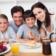 Family having healthy breakfast together — Stock Photo #10317018