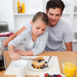 Little girl eating pancakes with her father — Stock Photo