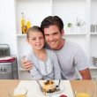 Father eating pancakes with his daughter in the kitchen — Stock Photo #10317027