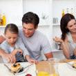 Young family having breakfast together — Stock Photo
