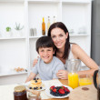 Portrait of  a mother and her son having breakfast — Stock Photo