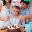 Cute girl celebrating her birthday with her family — Stock Photo