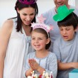 Portrait of a smiling family celebrating a birthday — Stock Photo