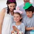Stock Photo: Portrait of a smiling family celebrating a birthday