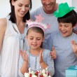 Portrait of a young family celebrating a birthday — Stock Photo
