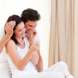 Happy couple finding out results of a pregnancy test — Stock Photo #10317123