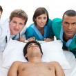 Medical team carrying a patient to intensive care unit — Stock Photo