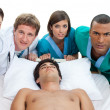 Medical team carrying patient to intensive care unit — Stock Photo #10317245