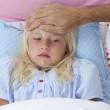 Sick girl in bed having flu — Stock Photo