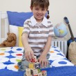 Little boy playing with alphabet cubes — Stock Photo