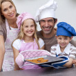 Family baking cookies in the kitchen — Foto Stock