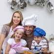 Happy family baking in the kitchen - Stock Photo