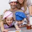 Family eating cookies after baking — Stock Photo