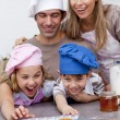 Children and parents eating cookies after baking — Stock Photo