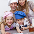 Happy children and parents eating cookies after baking — Stock Photo