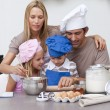 Royalty-Free Stock Photo: Children baking cookies with their parents