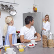 Family preparing breakfast in the kitchen — Stock Photo