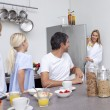 Stock Photo: Family preparing breakfast in the kitchen