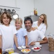 Stock Photo: Parents and children having breakfast together