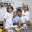 Stock Photo: Family having breakfast together