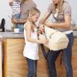 Stock Photo: Mother and daughter preparing the bag for school