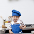 Little boy with blue hat and apron baking — Foto de Stock