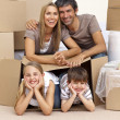 Stock Photo: Family in new house playing with boxes