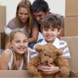 Little boy and girl moving house with parents — Stock Photo