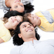 United family lying on the floor together — Stock Photo