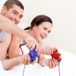 Happy couple playing video games — Stock Photo #10317508