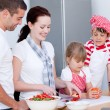 Portrait of a adorable family preparing a meal — Stock Photo