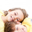 Happy childrens lying on the floor together — Stock Photo