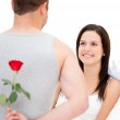 Handsome man hidding a rose — Stock Photo #10317555