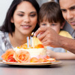 Happy family celebrating a birthday together — Stock Photo #10317572