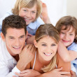 Stock Photo: United family waching television