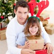 Stock Photo: Handsome father celebrating christmas with his daughter