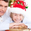 Stock Photo: Bright father celebrating christmas with his son