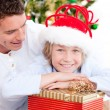 Handsome father celebrating christmas with his son - Stock Photo