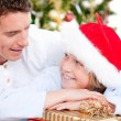 Attractive father celebrating christmas with his son — Stock Photo #10317633