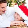 Attractive father celebrating christmas with his son - Stock Photo
